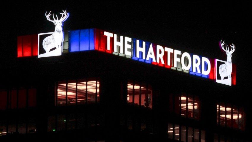 The Hartford sign lit up at night