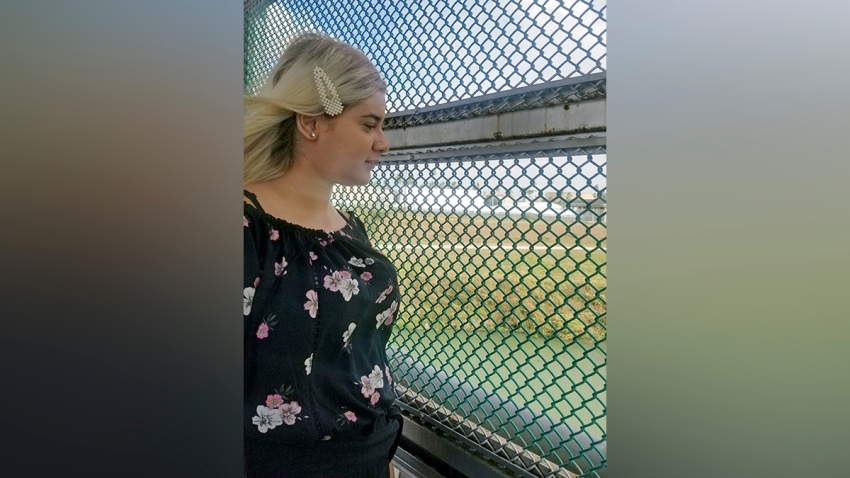 Venezuelan teen Branyerly stands on an international bridge connecting Brownsville, Texas, and Matamoros, Mexico, after the United States rejected her asylum claim.
