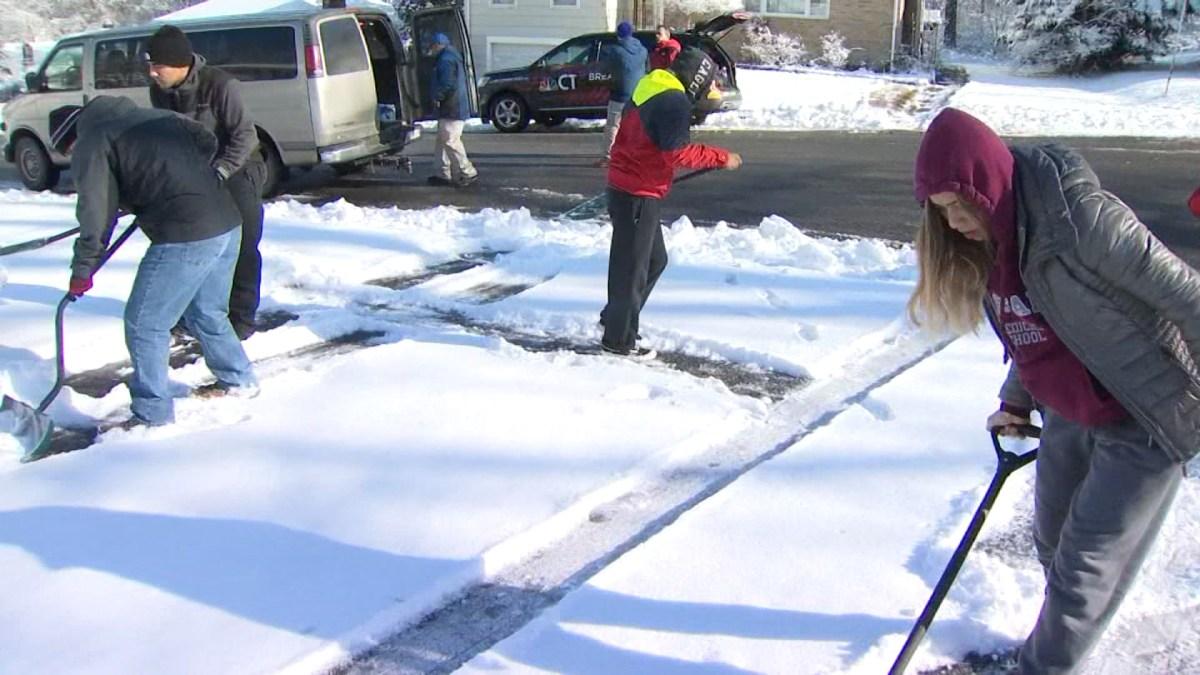 Teens Help Shovel Driveways in Waterbury