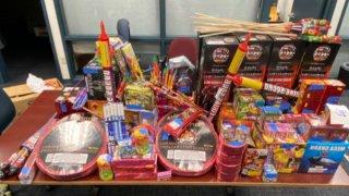 police display fireworks seized during an arrest in Hartford