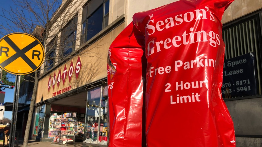 parking meter covered with Season's Greetings sign