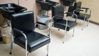 Hair Salon - a row of hair washing sinks and chairs.