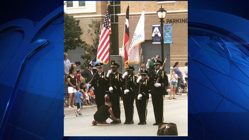 During the 4th of July parade in Arlington Thursday, a boy from the crowd ran out into the parade right in front of the Arlington Police Department Honor Guard.