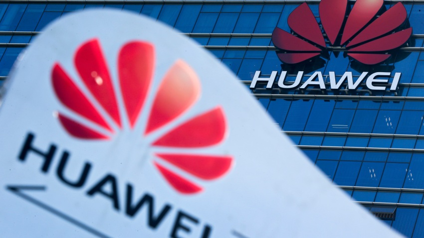 This Tuesday, Dec. 18, 2018, file photo, shows company signage on display near the Huawei office building at its research and development center in Dongguan, in south China's Guangdong province.