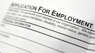 This file photo shows an employment application form on a table