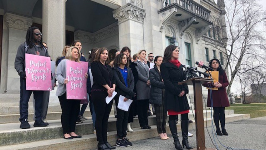 People gather for news conference on lawsuit filed over women's sports