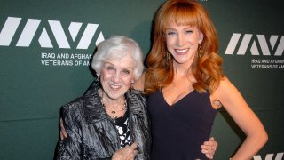 In this file photo, TV personality/comedienne Kathy Griffin (R) and her mom Maggie Griffin attend the Iraq And Afghanistan Veterans Of America's 5th Annual Heroes Celebration on May 8, 2013 at the Mr. C Beverly Hills in Beverly Hills, California.