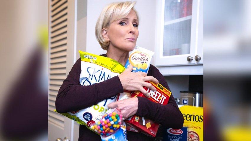 Mika Brzezinski clutching a variety of snacks.