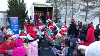Kids help fill a truck with toys during the NBC Connecticut and Telemundo Connecticut annual toy drive.