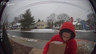man in red hoodie captured on doorbell camera