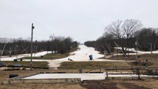 grassy areas showing in the snow at Powder Ridge