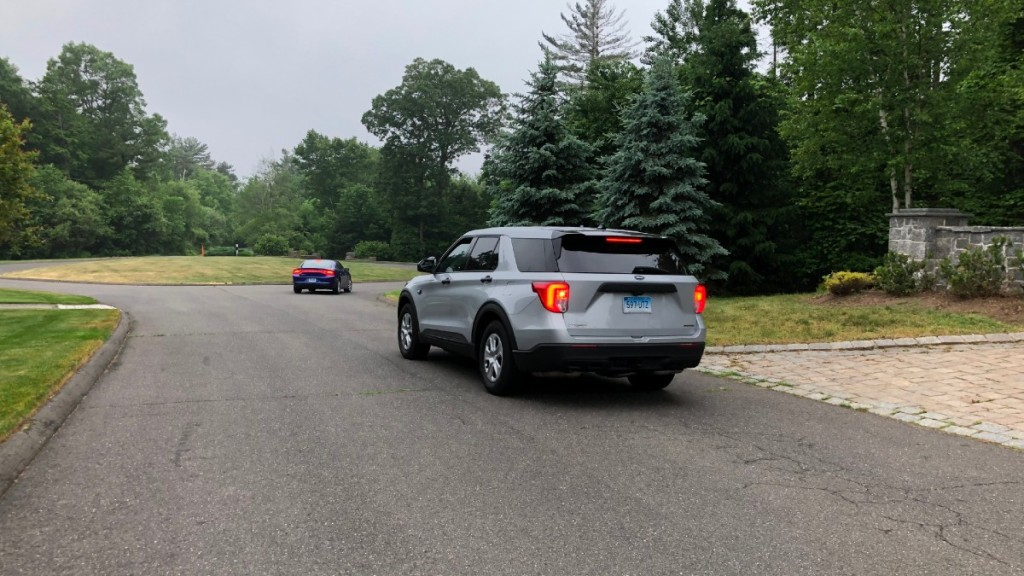 police vehicles enter driveway of 44 Sky View Drive in Avon
