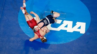 Bo Nickal of the Penn State Nittany Lions attempts a body slam of Nathan Traxler of the Stanford Cardinal in the 197 lbs weight class quarterfinals during the Division I Men's Wrestling Championship