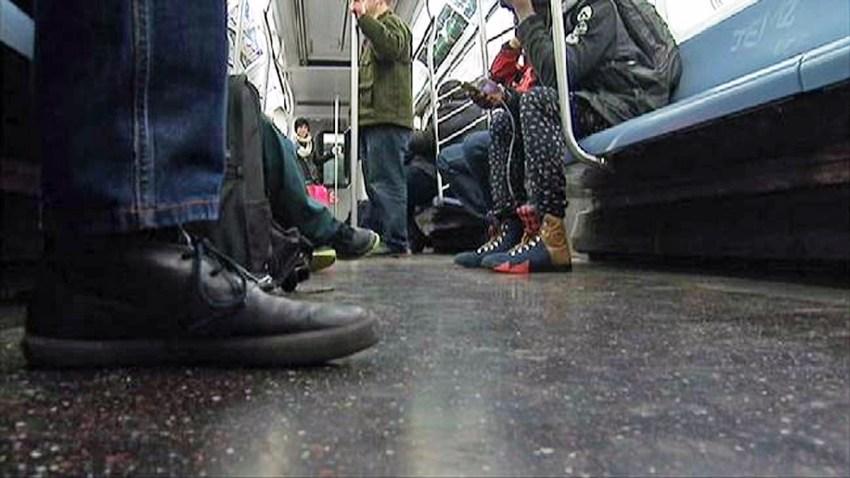 subway car doors feet