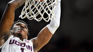 Connecticut's Christian Vital (1) dunks to put the team ahead during the second half of an NCAA college basketball game against South Florida Sunday, Feb. 23, 2020, in Storrs, Conn.