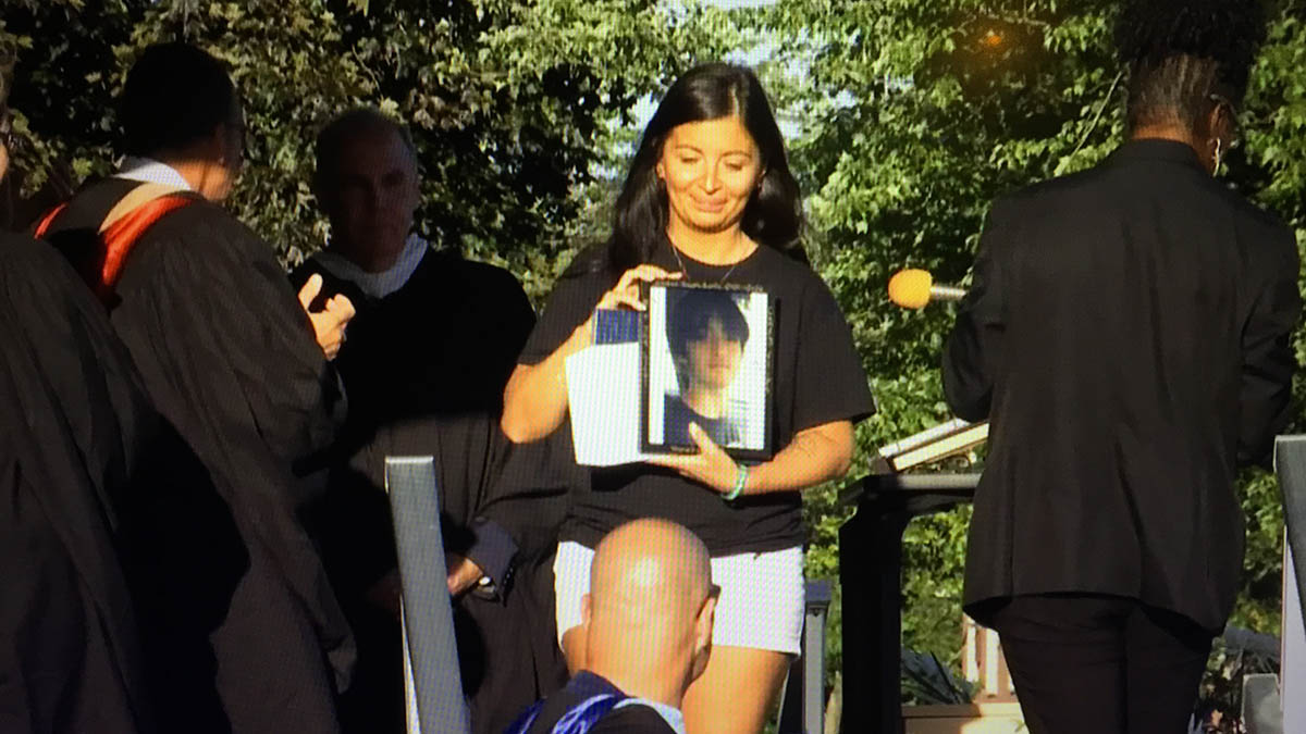 mom accepts honorary diploma for late son at wethersfield