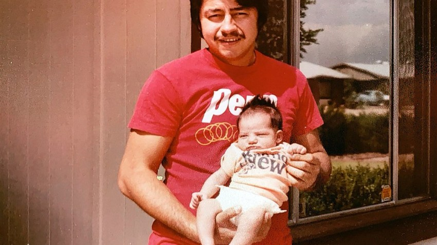 "The family of Mark Anthony Urquiza, seen here holding his daughter Kristin as a newborn, touched a nerve when they blasted elected officials for their ""carelessness"" in response to the coronavirus pandemic. Urquiza died of COVID-19 in Arizona."