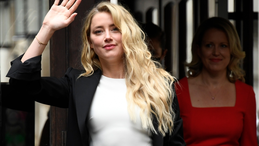 Amber Heard arrives at High Court, in London, Monday, July 27, 2020. Hollywood actor Johnny Depp is suing News Group Newspapers over a story about his former wife Amber Heard, published in The Sun in 2018 which branded him a 'wife beater', a claim he denies.