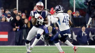 FOXBOROUGH, MA - JANUARY 04: New England Patriots wide receiver Mohamed Sanu Sr. (14) fields a punt during an AFC Wild Card game between the New England Patriots and the Tennessee Titans on January 4, 2020, at Gillette Stadium in Foxborough, Massachusetts.