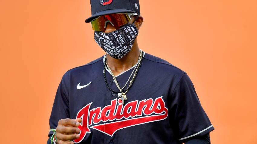 Francisco Lindor #12 of the Cleveland Indians warms up on the field wearing a face mask prior to an intrasquad game during summer workouts at Progressive Field on July 09, 2020 in Cleveland, Ohio.