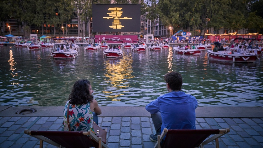 Parisians watch a floating cinema