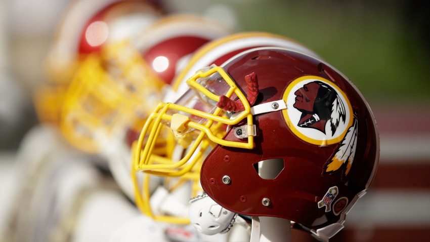 In this Nov. 23, 2014, file photo, Washington Redskins helmets sit on the sideline during their game against the San Francisco 49ers at Levi's Stadium in Santa Clara, California.