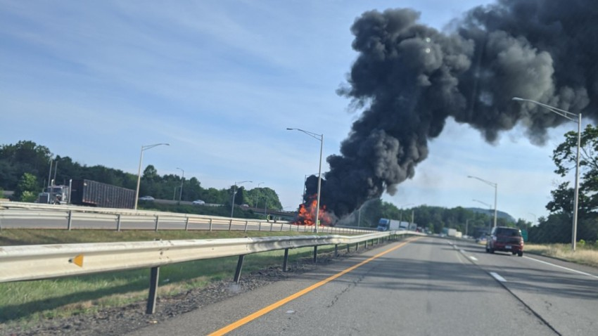 smoke and flames billow from a truck on Interstate 91 in Meriden
