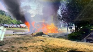 a burning vehicle after a crash in Norwalk