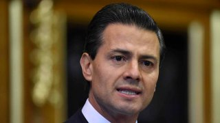 In this March 3, 2015, file photo, Mexico's President Enrique Pena Nieto delivers an address to members of the British All-Party Parliamentary Group at the Houses of Parliament in London, England.