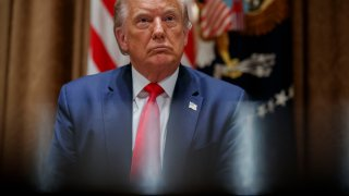 President Donald Trump listens during a meeting with U.S. tech workers, before signing an Executive Order on hiring American workers, in the Cabinet Room of the White House, Monday, Aug. 3, 2020, in Washington.