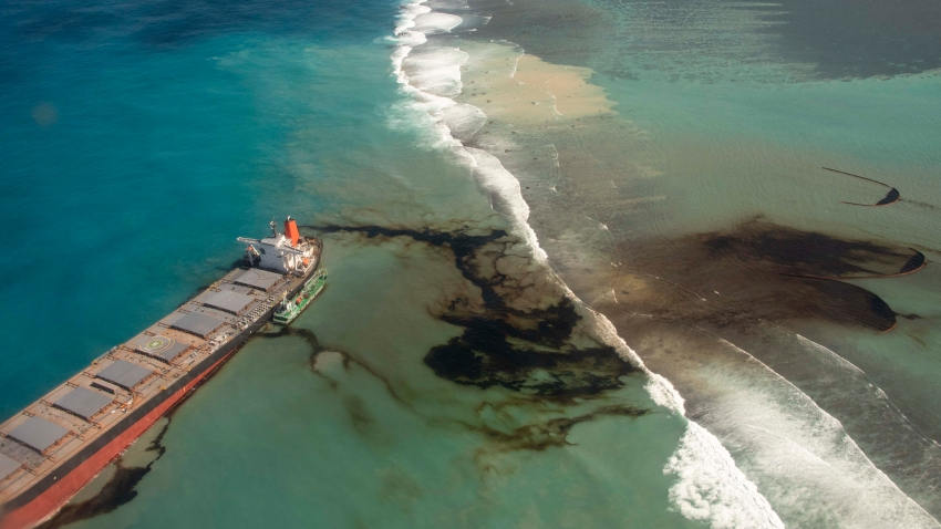 This photo provided by the French Defense Ministry shows oil leaking from the MV Wakashio, a bulk carrier ship that recently ran aground off the southeast coast of Mauritius, Sunday Aug.9, 2020