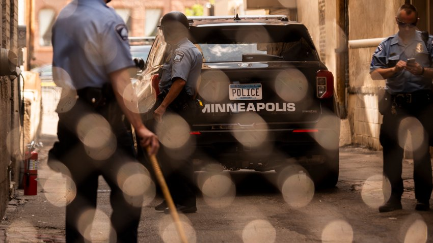 MINNEAPOLIS, MN - JUNE 13: Members of the Minneapolis Police Department seen through a chain link gate on June 13, 2020 in Minneapolis, Minnesota. The MPD has been under scrutiny from residents and local city officials after the death of George Floyd in police custody on May 25.