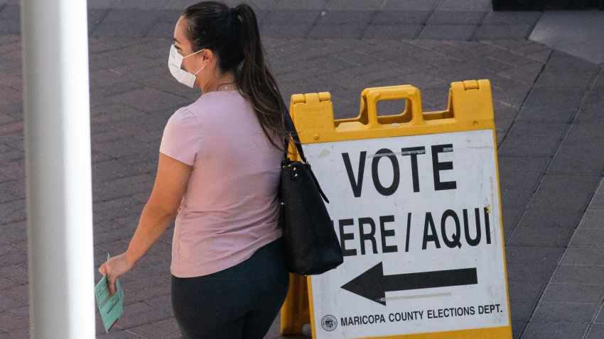 PHOENIX, AZ - AUGUST 04: A voter waits to cast their ballot during Arizona's primary election at Biltmore Fashion Park on August 4, 2020 in Phoenix, Arizona. Larger venues have been catered to allow for social distancing as adjustments are made in light of the coronavirus pandemic.