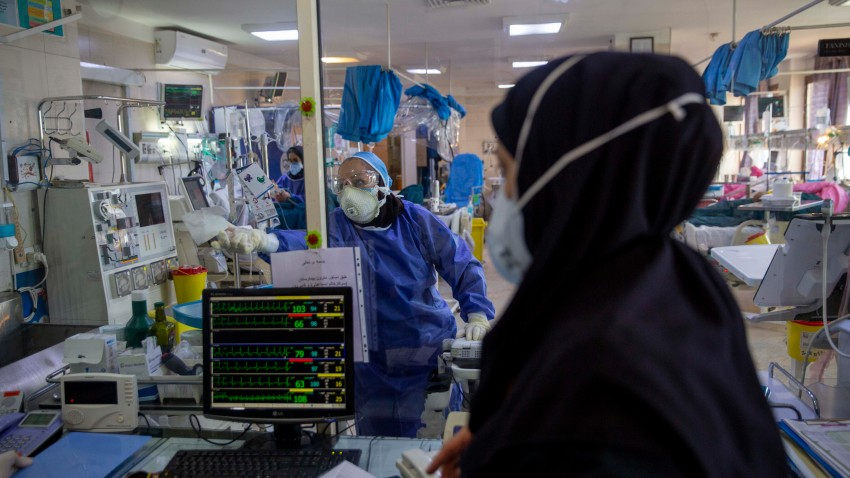 Medical personnel wearing protective suits work at a new coronavirus (COVID-19) section of the Masih Daneshvarii Hospital on August 19, 2020 in Tehran, Iran.
