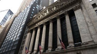 NEW YORK, NEW YORK - JULY 23: American flags are on display on the New York Stock Exchange (NYSE) on July 23, 2020 in New York City. On Wednesday July 22, the market had its best day in 6 weeks.