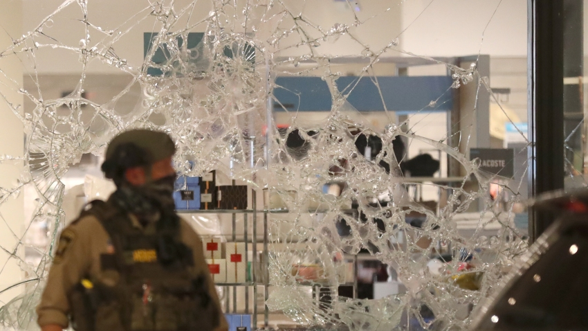 A broken window at Nordstrom Rack is seen during unrest near 7th St. S. and Nicollet Mall in Minneapolis on Aug. 26, 2020.