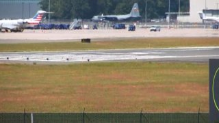 c-130 sits on the runway at Bradley Airport