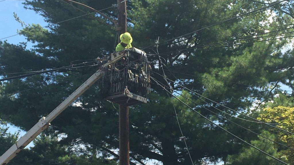eversource lineman working in a bucket truck