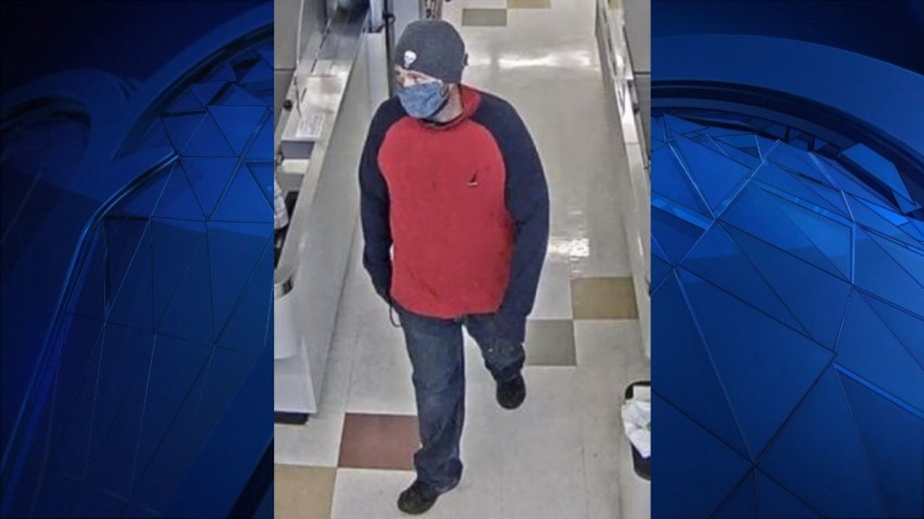 surveillance photo of a bank robbery suspect