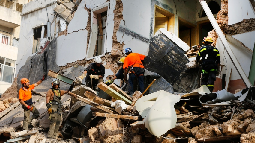 Chilean and Lebanese rescuers search in the rubble of a building that was collapsed in last month's massive explosion, after getting signals there may be a survivor under the rubble, in Beirut, Lebanon, Thursday, Sept. 3, 2020. Hopes were raised after the dog of a Chilean search and rescue team touring Gemmayzeh street, one of the hardest-hit in Beirut, ran toward the collapsed building.