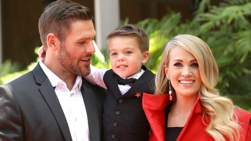 Carrie Underwood poses with her husband, Mike Fisher and their son, Isaiah Michael Fisher