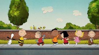 """Peanuts"" characters walk along sidewalk"
