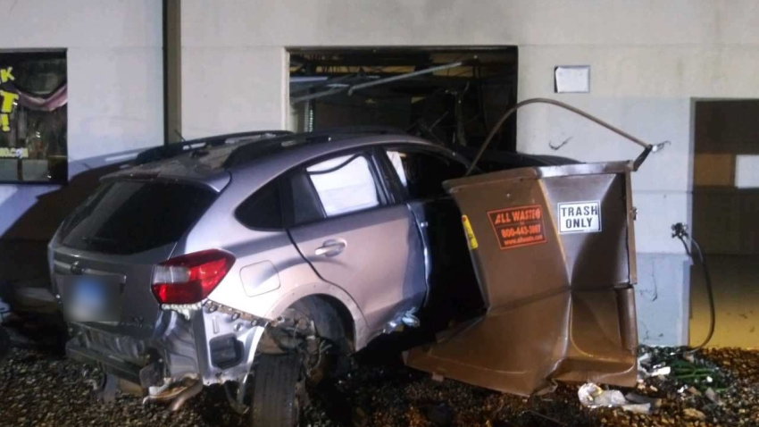 Vehicle crashes into a building in Newington