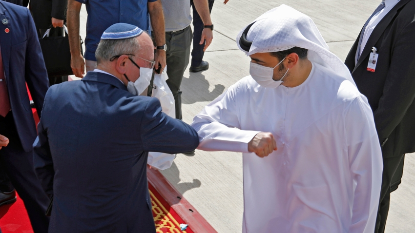 Israeli National Security Advisor Meir Ben-Shabbat elbow bumps with an Emirati official ahead of boarding the plane before leaving Abu Dhabi, United Arab Emirates September 1, 2020.