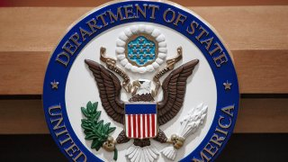 The U.S. Department of State seal is seen on the podium-lectern area, Nov. 26, 2013, in the State Department briefing room in Washington, D.C.