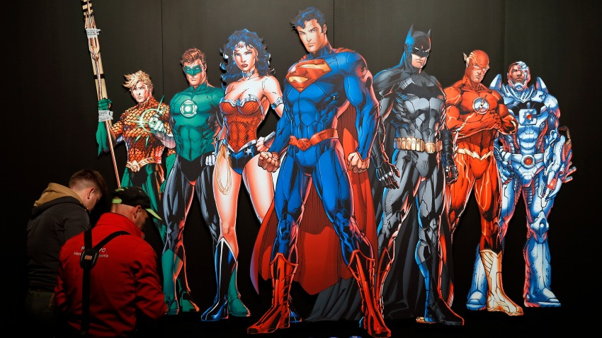"""In this April 26, 2018, file photo, a DC Comics universe poster of Batman, Superman, Wonder Woman, The Joker, The Flash and others is displayed during the press preview of the exhibition """"The Art of the Brick: DC Super Heroes"""" at Parc de la Villette in Paris, France."""