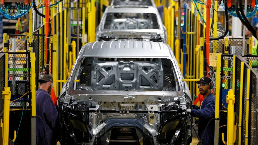 Workers assemble cars at the newly renovated Ford's Assembly Plant in Chicago