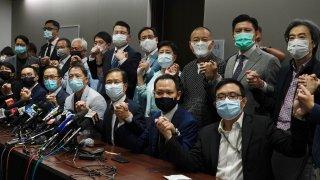 Hong Kong's pro-democracy legislators pose for a photo before a press conference at Legislative Council in Hong Kong, Wednesday, Nov. 11, 2020.