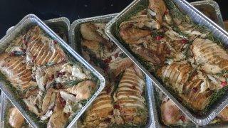 trays full of sliced turkey