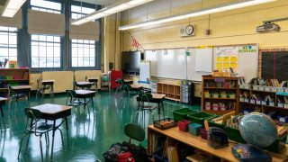 Students' desk adhere to social distancing requirements in a classroom at a public elementary school in the Brooklyn borough of New York